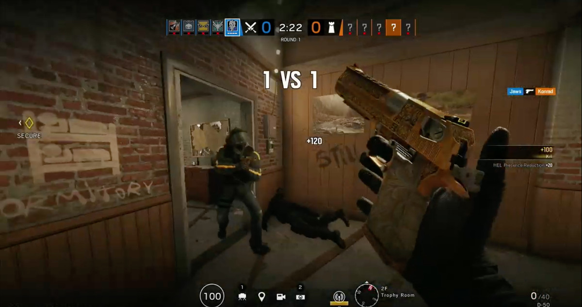 In-game shot showing a golden gun reloading in Rainbow Six Siege