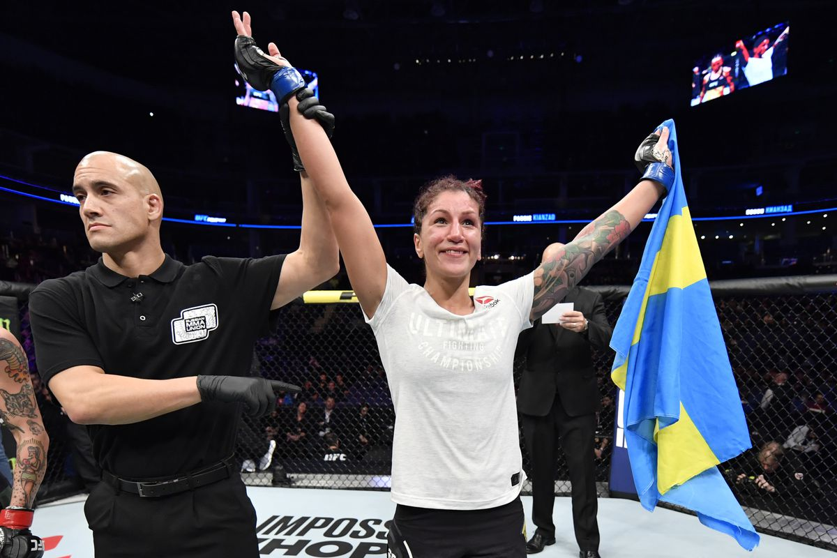 Pannie Kianzad of Iran celebrates after defeating Jessica-Rose Clark of Australia in their bantamweight bout during the UFC Fight Night event at CSKA Arena on November 09, 2019 in Moscow, Russia.