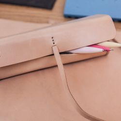 """<b>AndreyAndShay</b> Vegetable Tanned Leather Pencil Case, <a href=""""http://mcnallyjacksonstore.com/store/andreyandshay-vegetable-tanned-leather-pencil-case/dp/126"""">$75</a>"""