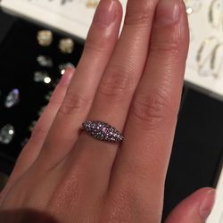 Sterling silver ring with small precious stones, $297