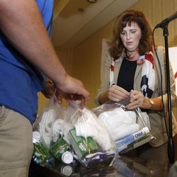 David Neilsen, a Utah alternate delegate and Joni Crane, from Utah assemble humanitarian kits in Tampa, Florida.  The Republican National Convention was put on hold because of Hurricane Isaac but the Utah delegates used their extra time to put together humanitarian kits on Monday.  Delegates from Hawaii and Arizona helped out with the 1,000 hygiene kits and 100 back-to-school kits. Monday, Aug. 27, 2012
