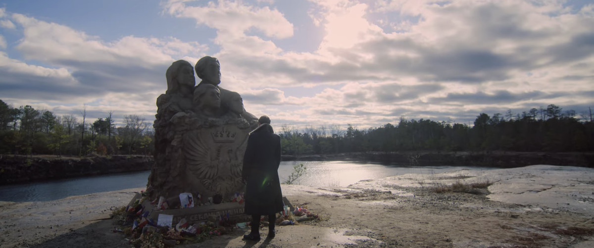 Zemo stands by a Sokovian memorial in Falcon and the Winter Soldier.
