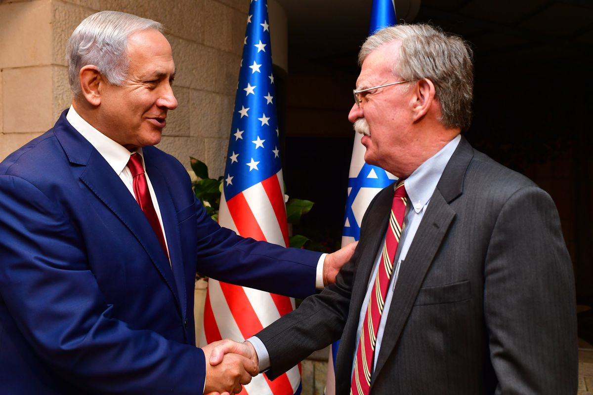 Israeli Prime Minister Benjamin Netanyahu shakes hands with White House National Security Adviser John Bolton as they meet on January 6, 2019 in Jerusalem, Israel.