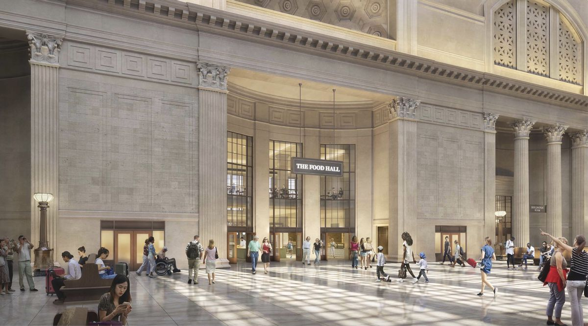 """A large train terminal with soaring ceilings and beaux arts architecture. Three doors topped by large windows and a sign reading """"The Food Hall"""" lead to the new dining space."""