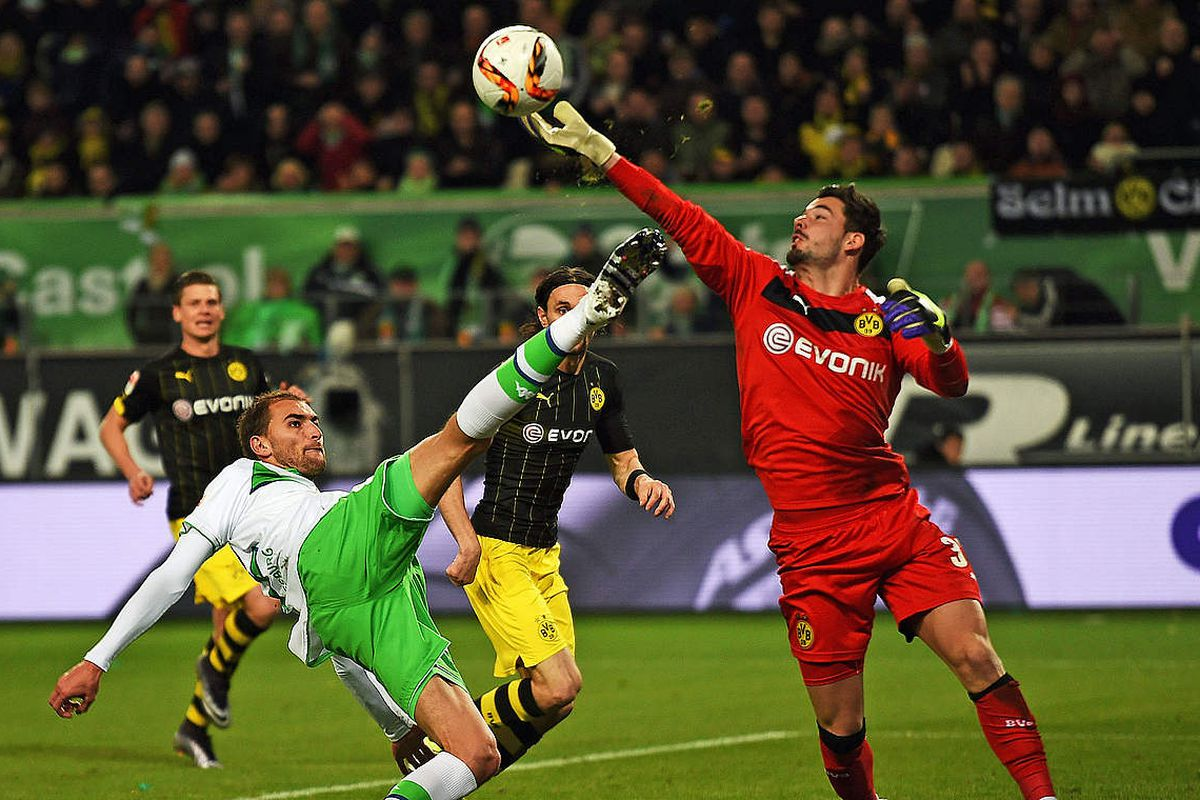 Bürki tips away Dost's effort after gifting him a golden chance in BVB's last gasp win against Wolfsburg