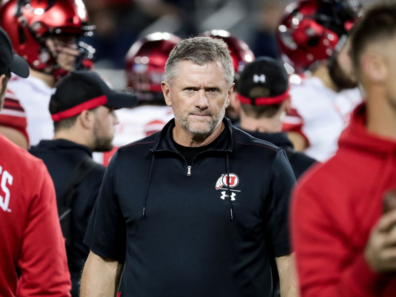 Utah Utes head coach Kyle Whittingham supervises the team as they warm up before the game against the Arizona Wildcats at Arizona Stadium in Tucson, Arizona on Saturday, Nov. 23, 2019.