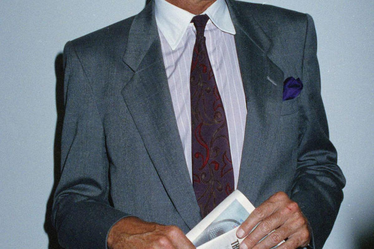 Frank Deford speaking in publisher of the sports daily on June 12, 1991, the National holding a dummy version of the final edition of the tabloid. (AP Photo/Susan Ragan)