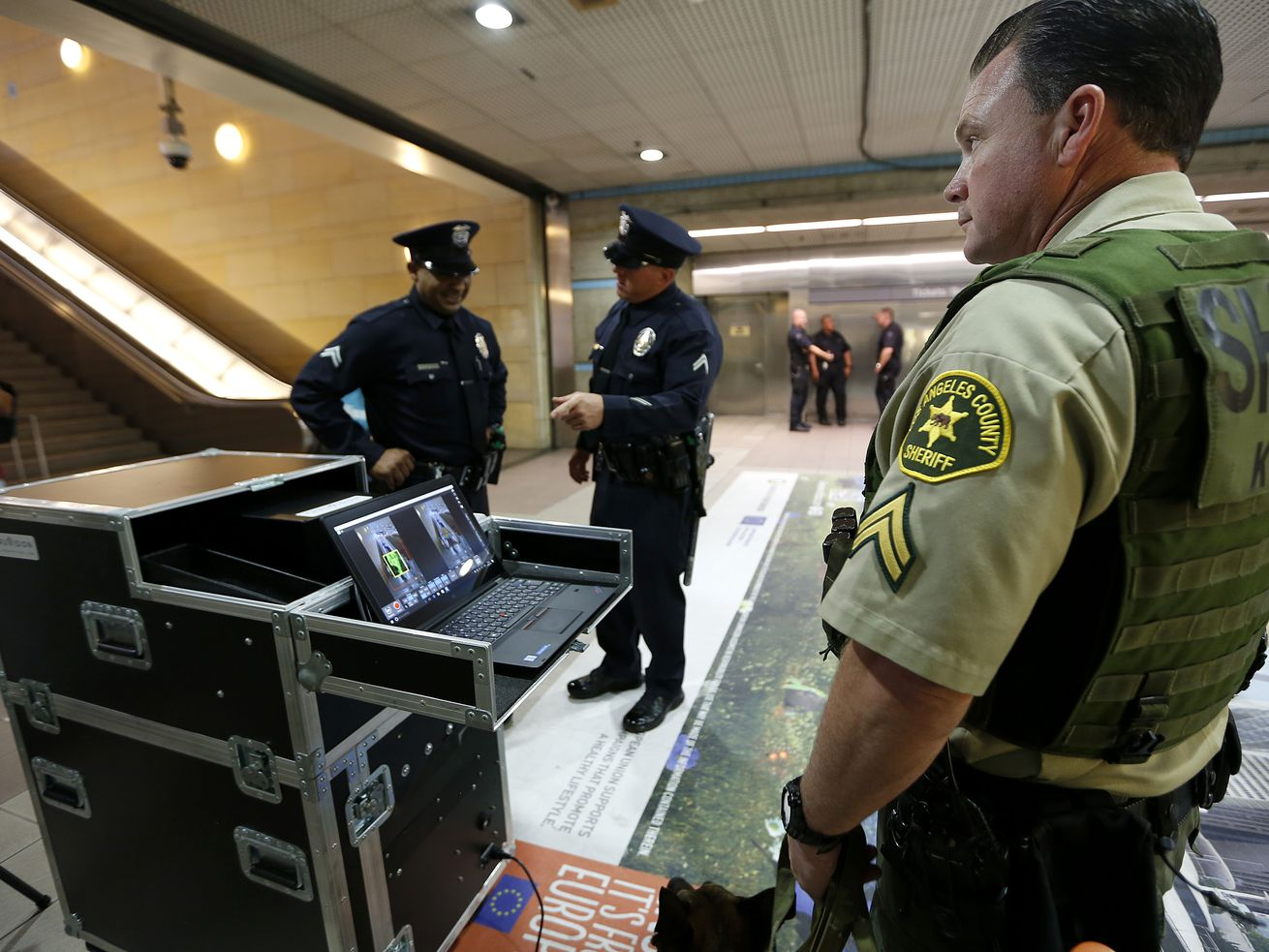 Officers testing the security devices in a Metro subway station.