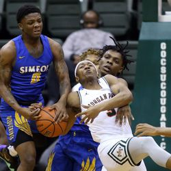 Morgan Park's Christian Roberts (3) runs into Simeon's Sincere Callwood (4) and Kejuan Clements (0) in their CPS semi final game at Chicago State University, Friday, February 15, 2019. | Kevin Tanaka/For the Sun Times