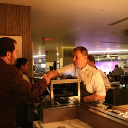 Voltaggio greeting a guest who had been advised to go to Range by a friend in Frederick. He is, however, disappointed that there is no Jack Daniels at the bar. Voltaggio assures him they have plenty of other fine whiskey.