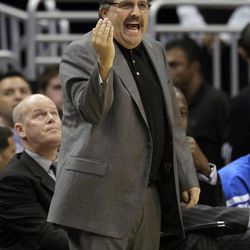 Orlando Magic head coach Stan Van Gundy shouts to his team on the court during the first half of an NBA basketball game against the Atlanta Hawks, Friday, April 13, 2012, in Orlando, Fla.