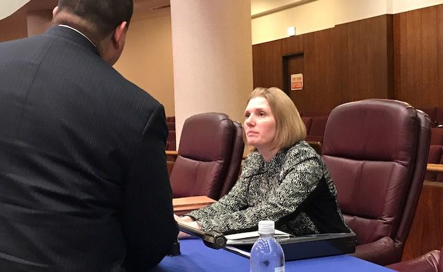 Transportation Commissioner Rebekah Scheinfeld talks to Plan Commission Chairman Martin Cabrera after Thursday's meeting in the City Council chambers. | Fran Spielman/Sun-Times