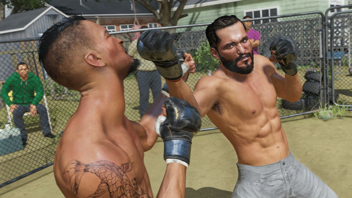 A goateed fighter lands a right uppercut in an improvised, chain-link-fence octagon in somebody's back yard.