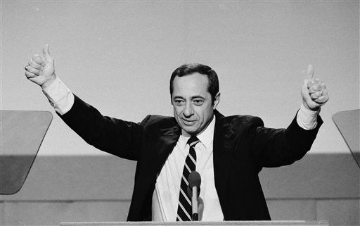 <small><strong>New York Gov. Mario Cuomo gives thumbs-up with both hands during his keynote address to the opening session of the Democratic National Convention in San Francisco on July 17, 1984. AP file photo</strong></small>