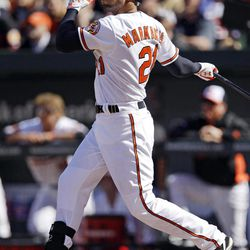 Baltimore Orioles' Nick Markakis hits a two-run home run in the first inning of the Orioles' home opener baseball game against the Minnesota Twins in Baltimore, Friday, April 6, 2012.