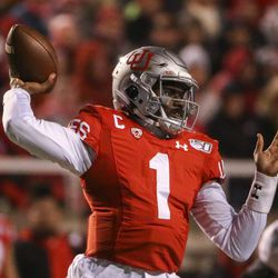 Utah Utes quarterback Tyler Huntley (1) makes a throw during the first half of an NCAA football game at Rice-Eccles Stadium in Salt Lake City on Saturday, Nov. 30, 2019.