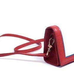 "<b>Hare + Hart</b> Mini Clutch in Poppy, <a href=""http://hareandhart.com/shop/handbags/mini-clutch-crimson-w-light-haircalf/"">$225</a> (from $495)"
