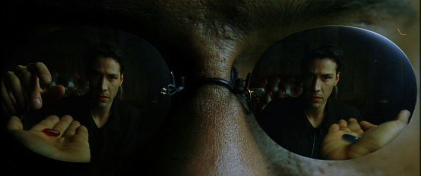 Neo in the reflection of Morpheus's sunglasses