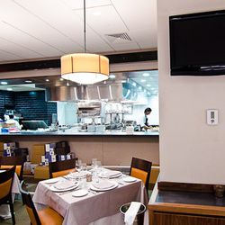 Five monitors spread throughout the space will display chef Enzo Fargione as he plates dishes.