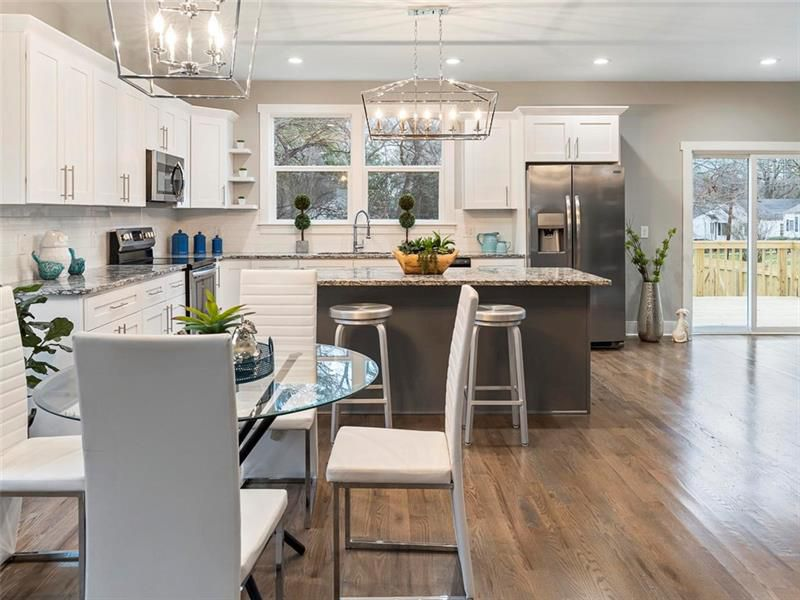 A dining and kitchen space in a white home.