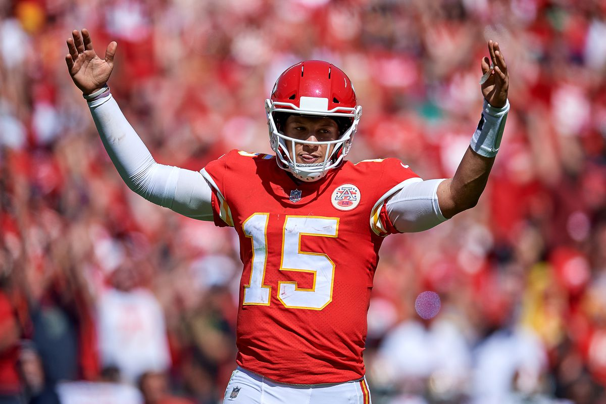 Kansas City Chiefs quarterback Patrick Mahomes (15) raises his arms as he celebrates after throwing for a touchdown in game action during a NFL game between the San Francisco 49ers and the Kansas City Chiefs on September 23, 2018, at Arrowhead Stadium in Kansas City, MO.
