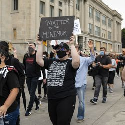Black Lives Matter protesters march around downtown Kenosha, Tuesday evening, Sept. 1, 2020. President Donald Trump visited Kenosha Tuesday after the police shooting of Jacob Blake led unrest in the Wisconsin city.