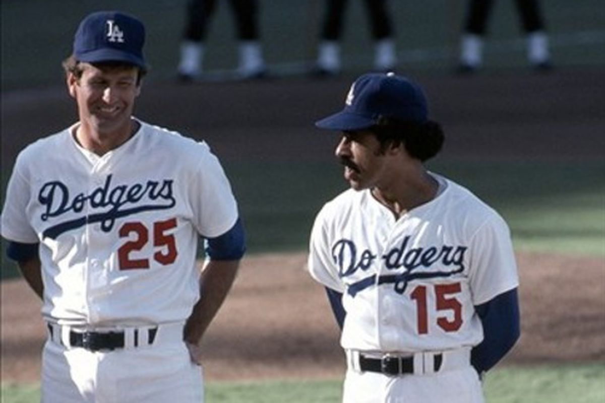 Tommy John, seen here with Davey Lopes, is one of 12 Hall of Fame expansion era finalists