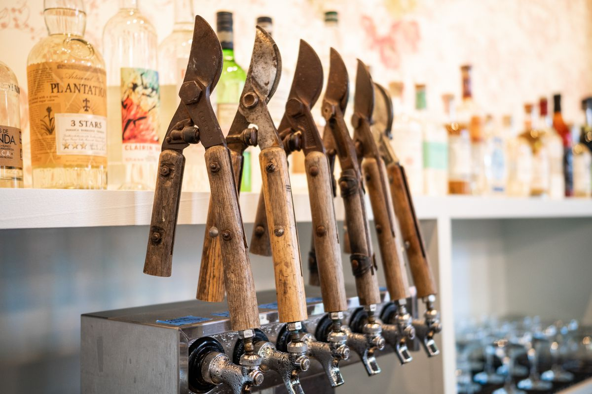 A closeup view of sharp cherry tree pruners that are being as bar taps.
