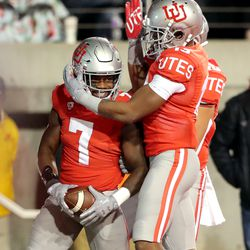 Utah Utes running back Devonta'e Henry-Cole (7) celebrates a touchdown with Utah Utes wide receiver Donte Banton (13) as Utah and UCLA play a college football game in Salt Lake City at Rice-Eccles Stadium on Saturday, Nov. 16, 2019. Utah won 49-3.