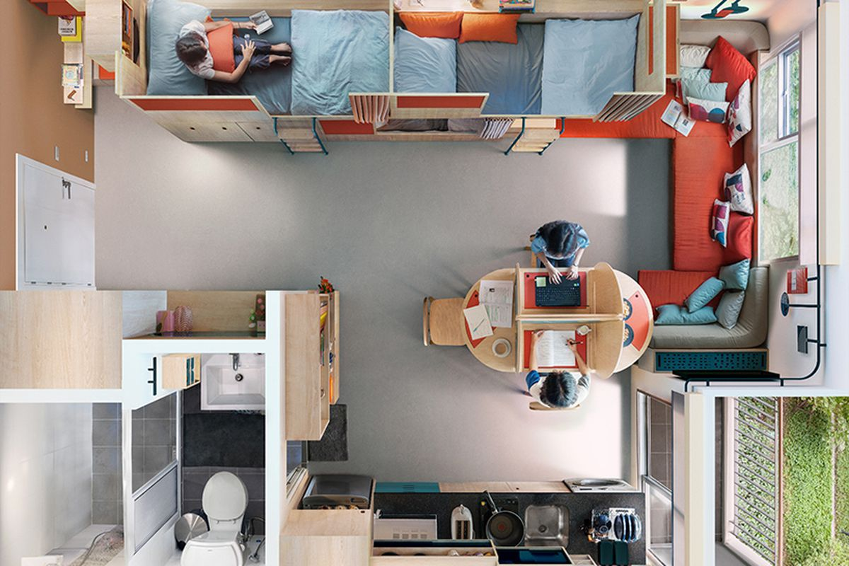 Aerial view of small apartment feature three built-in bunk beds, a built-in bench, small dining table, small bathroom and kitchen, and a small balcony.