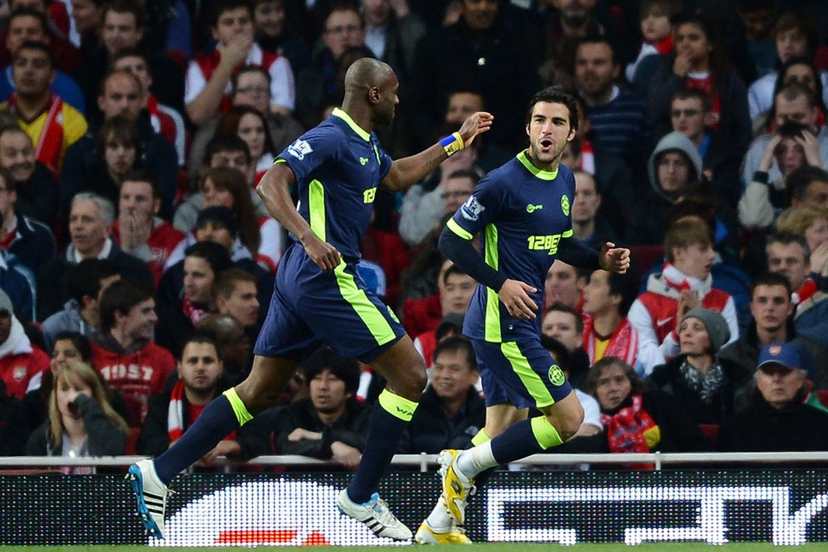 Jordi Gomez of Wigan celebrates scoring their second goal with Emmerson Boyce of Wigan during the Barclays Premier League match between Arsenal and Wigan Athletic at Emirates Stadium.