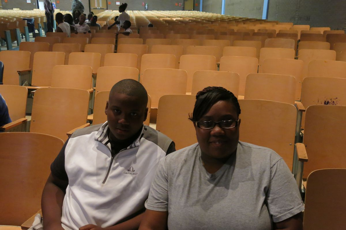 Riverview seventh grader Anthony Poindexter Jr and his mother Lysandra Bradford filled out his registration paperwork on the first day of school on Aug. 4. Poindexter plans to work harder in reading this year.