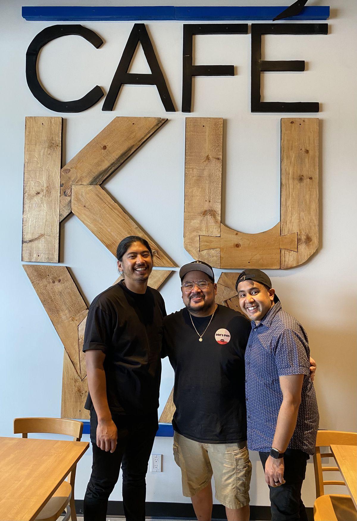 three men in cafe