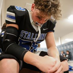 A Stansbury player looks down as he prepares for a high school football game against Tooeleat Stansbury High School in Stansbury Park on Friday, Sept. 17, 2021.