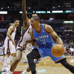 Oklahoma City Thunders' Russell Westbrook(0) drives against Milwaukee Bucks' Brandon Jennings during the first half of an NBA basketball game Monday, April 9, 2012, in Milwaukee.
