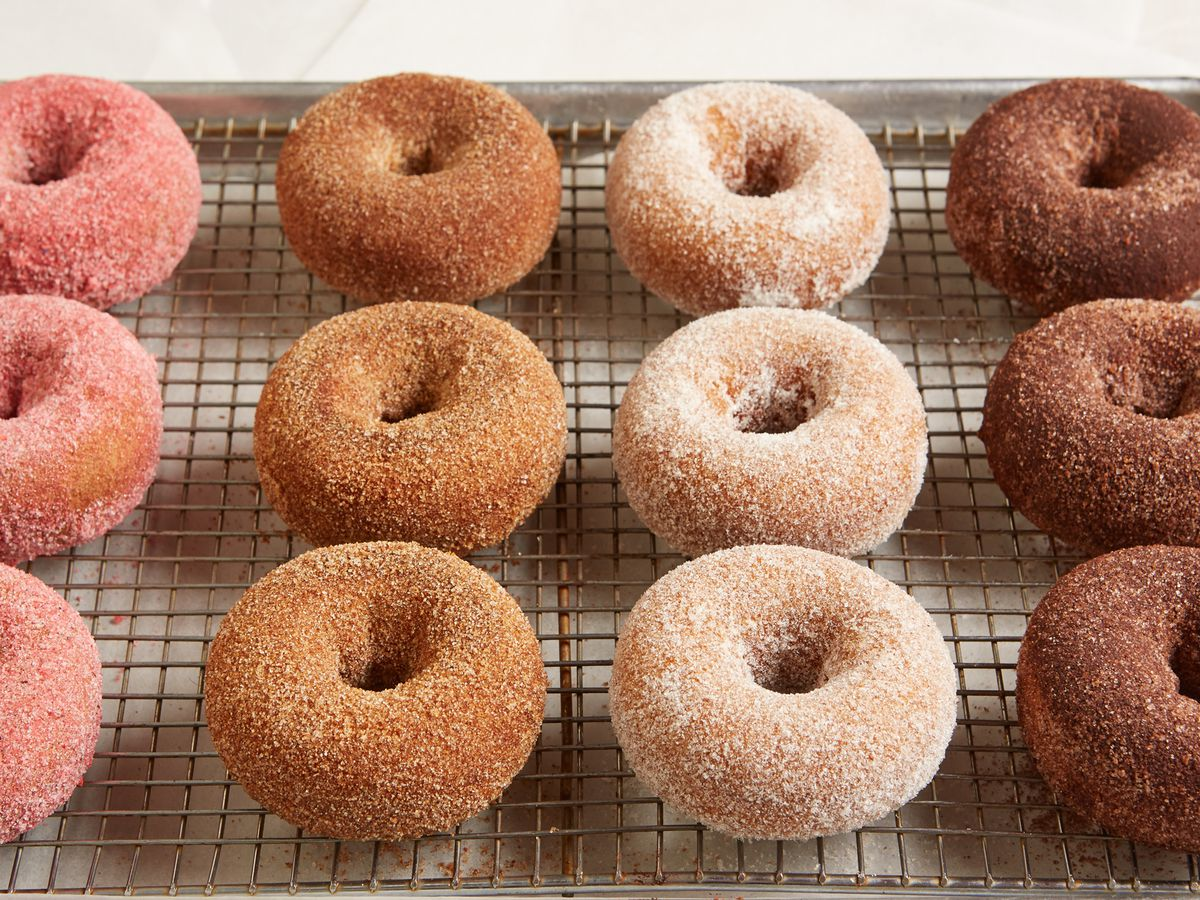 row of doughnuts on cooling rack