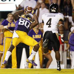 LSU wide receiver Jarvis Landry (80) catches a touchdown pass as Idaho cornerback Jayshawn Jordan (4) covers in the first half of their NCAA college football game in Baton Rouge, Saturday, Sept. 15, 2012.