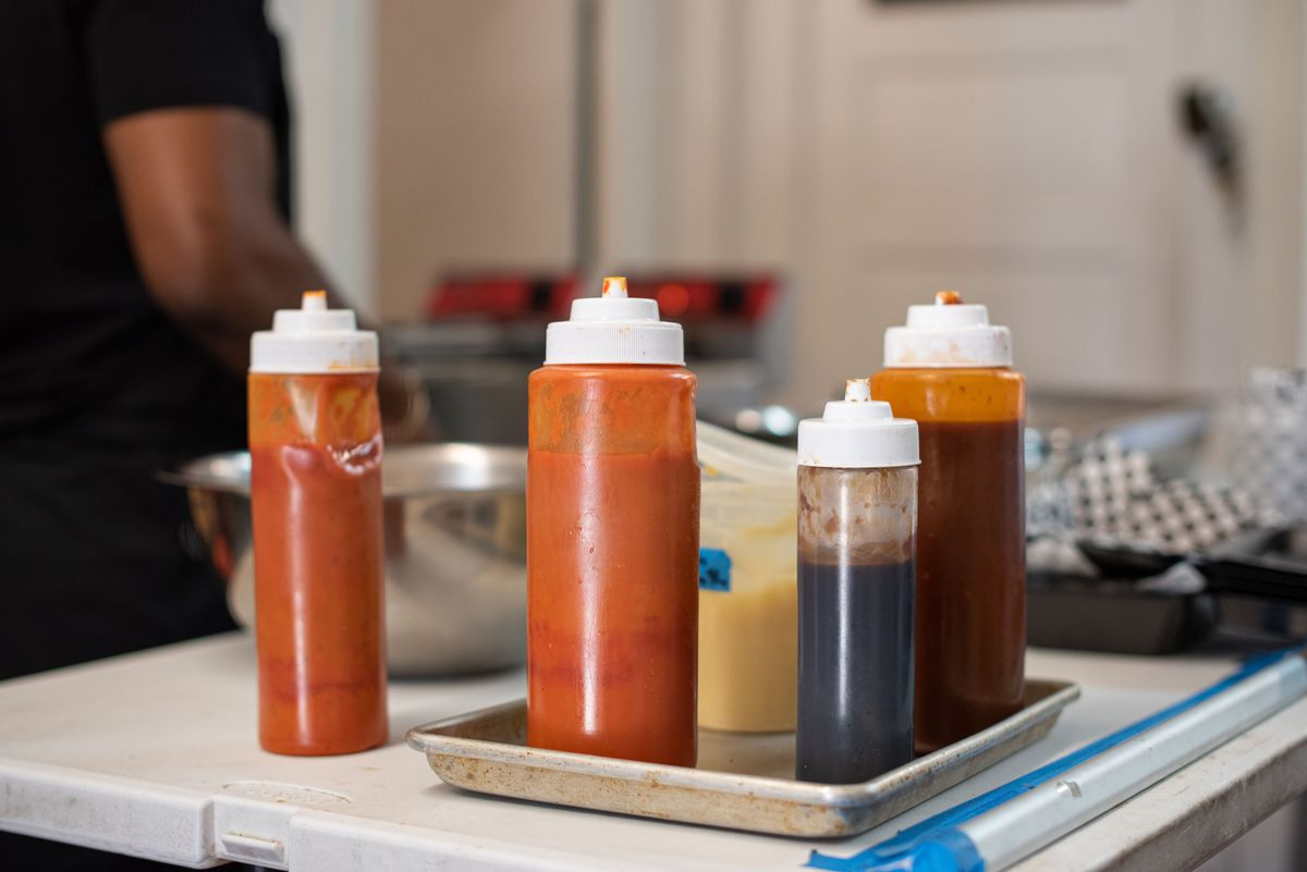 A variety of sauces in different size bottles at the ready.