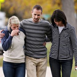 Family members leave speaking about Russell Jacobs in East Millcreek, Friday, Oct. 30, 2015. They are Kallie Stolk, left, niece, Brian Stolk, nephew, and Lyne Miller, a cousin to Russell Jacobs' wife. Jacobs died after being shot Oct. 29, 2015.