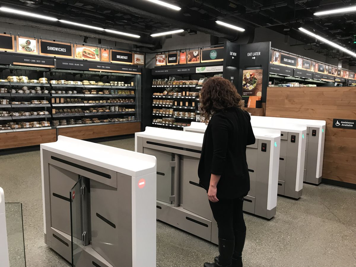A shopper scans her phone to enter the new Amazon Go convenience store in Seattle.