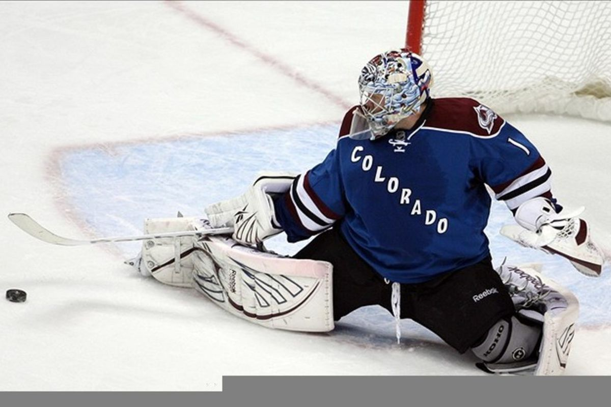 March 10, 2012; Denver, CO, USA; Colorado Avalanche goalie Semyon Varlamov (1) blocks a shot during the first period against the Edmonton Oilers at the Pepsi Center.  Mandatory Credit: Chris Humphreys-US PRESSWIRE