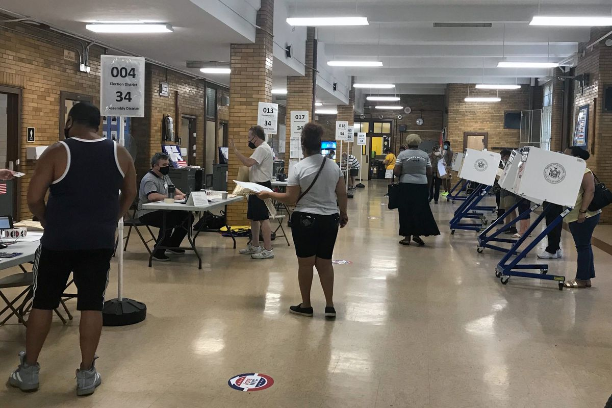 People vote during the Democratic primary at PS 149 in Jackson Heights, Queens, June 23, 2020.