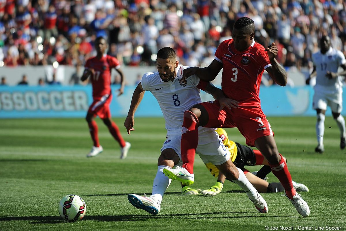 Clint Dempsey fights off a defender to score the second goal in the USA's 2-0 victory over Panama
