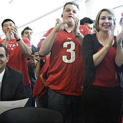 University of Utah supporters react as the U. accepts the invitation to join the Pac-10 Athletic Conference at Rice-Eccles Stadium in Salt Lake City Thursday.