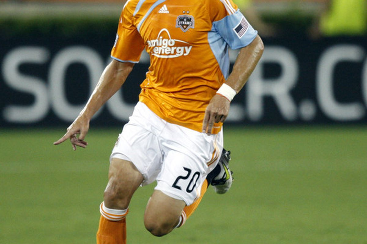 HOUSTON - SEPTEMBER 18:  Geoff Cameron #20 of the Houston Dynamo brings the ball up the field against the Toronto FC at Robertson Stadium  on September 18 2010 in Houston Texas.  (Photo by Bob Levey/Getty Images)