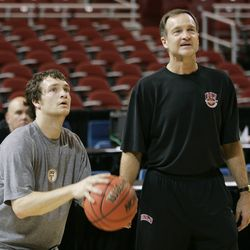 UNLV's Kevin Kruger, left, puts up a shot while UNLV's coach Lon Kruger looks on during practice for their NCAA Midwest Regional semifinal basketball game in St. Louis, Thursday, March 22, 2007. UNLV will play Oregon on Friday.