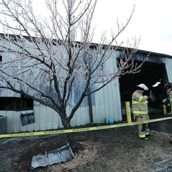 Firefighters investigate a blaze at the public works building in Sandy on Friday, Jan. 27, 2017.