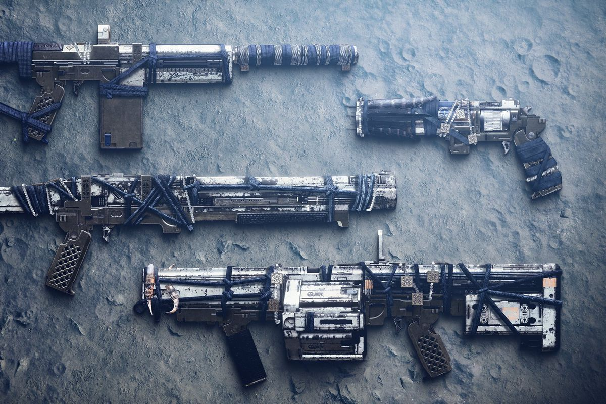 four weapons laying on a rock surface in Destiny 2