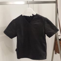 """Leather t-shirt, <a href=""""http://us.topshop.com/en/tsus/product/clothing-70483/the-collection-starring-kate-bosworth-2383321/leather-t-shirt-2345197?bi=1&ps=200"""">$160</a>."""