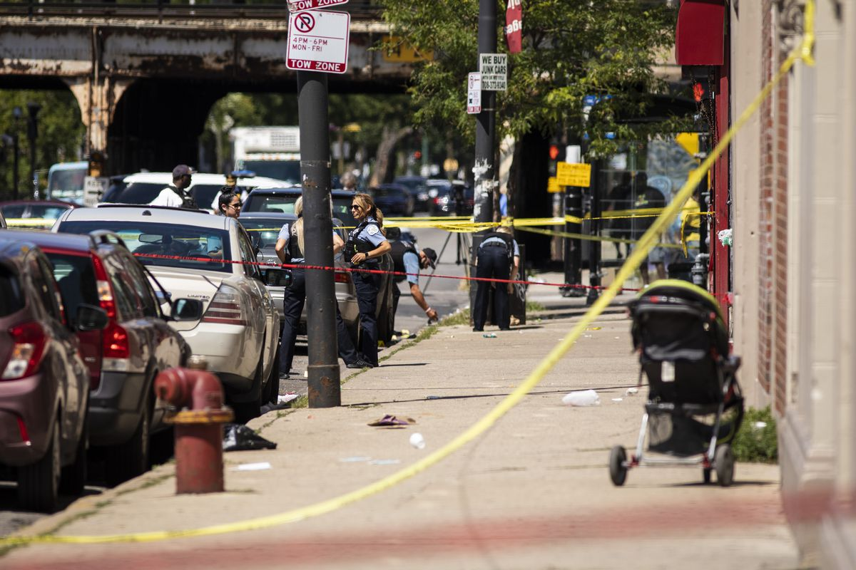 Chicago police investigate in the 300 block of North Central after a 9-year-old boy and his 27-year-old mother were shot Wednesday afternoon, Aug. 19, 2020.